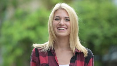 Young Happy Blonde Woman Smiling in the Streets Outdoors