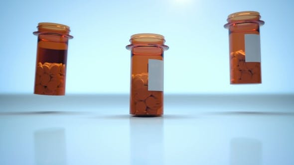 Thumbnail for Three Containers with Medical Pills Falling on Blue Glossy Background
