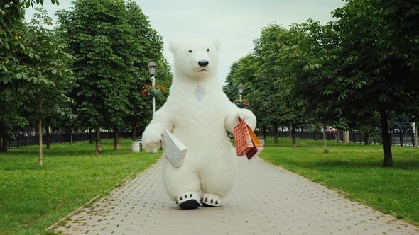 Thumbnail for Successful Shopping, a Polar Bear Walks in the Park with Packages for Shopping