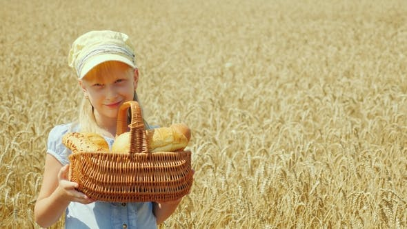 Thumbnail for Portrait of a Girl with a Basket of Bread on a Wheat Field Sufficient and Good Harvest