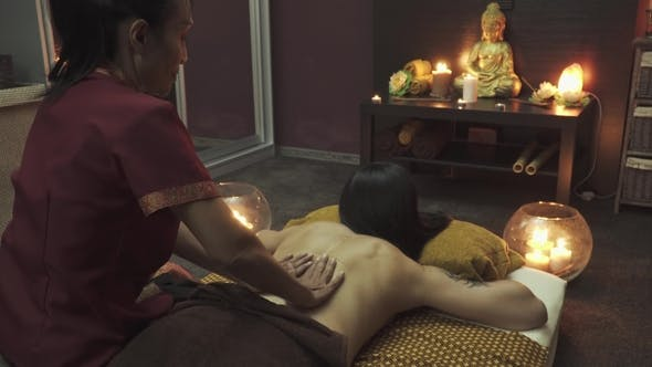 Thumbnail for Pretty Masseuse Does a Back Massage To Girl