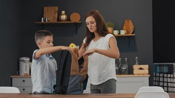Mom Prepares Lunch for Her Son at School