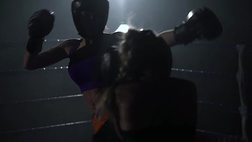 Sparring in the Ring Between the Girls