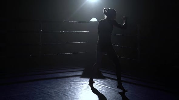 Thumbnail for Girl Trains, Boxing in the Ring. Silhouette