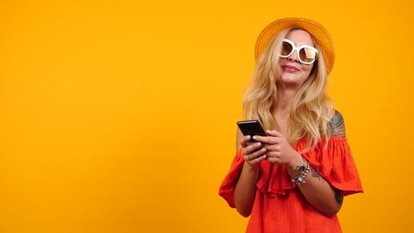 Thumbnail for Happy Woman Looks at Her Smartphone and Recieves a Good News