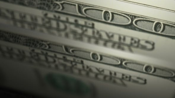 Counting Cash Hundred Dollar Bills with Depth of Field Seamless Animation