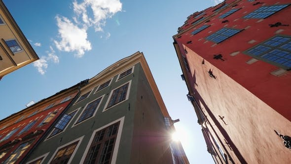Thumbnail for Multicolored Old Houses in Stockholm. Beautiful European Architecture, the Sun Shines From Behind