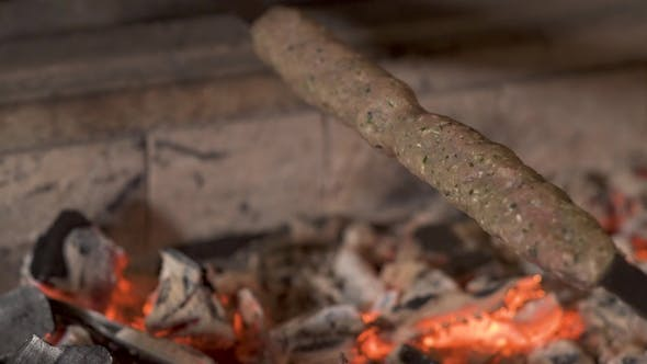 Thumbnail for Delicious Kebab Is Pepraring on Skewer on a Hot Coals