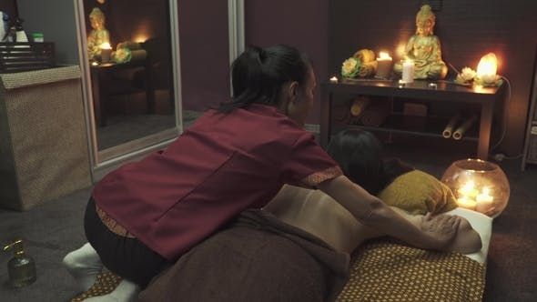 Thumbnail for Nice Masseuse Sits on the Girl and Does a Back Massage