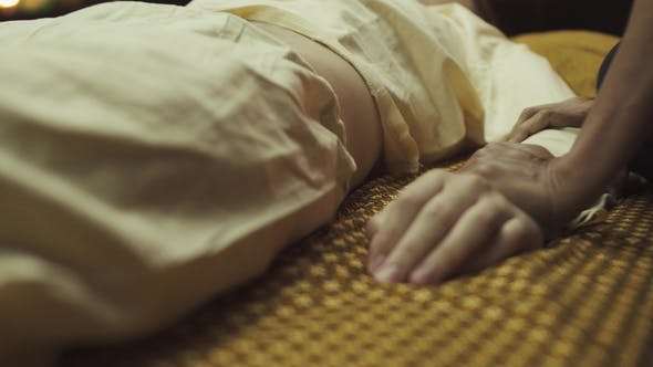 Thumbnail for Thai Masseuse Slowly Massaging Client's Hand and Arm