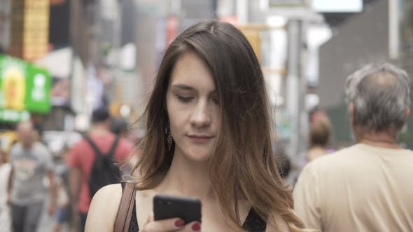 Portrait of Young Woman Using Smartphone If Crowded Downtown of New York America
