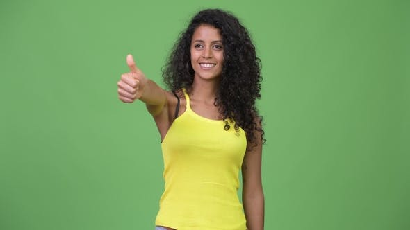 Cover Image for Young Beautiful Hispanic Woman Giving Thumbs Up