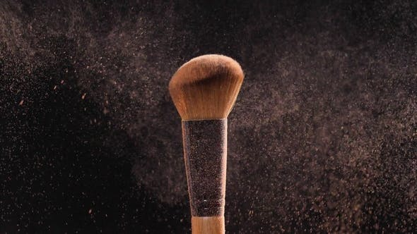 Thumbnail for Makeup and Beauty Concept Makeup Brush with Orange Powder