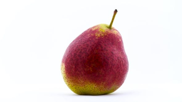 Thumbnail for One Pear Fruit Is Rotating on the White Background Isolated