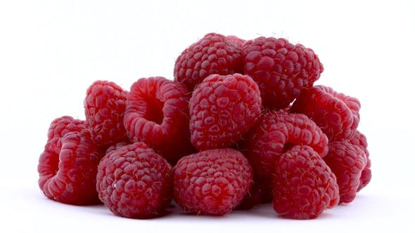Thumbnail for Heap of Raspberries Are Rotated on the on the Turntable Isolated on the White Background. . Side