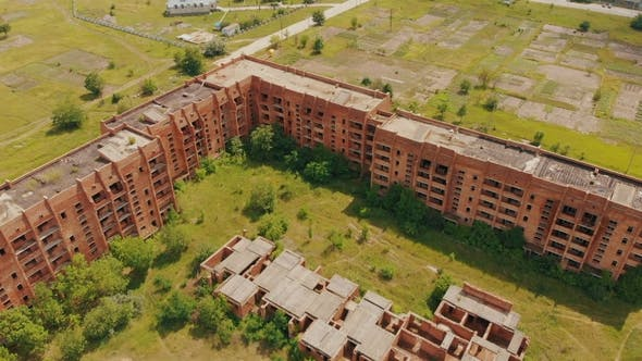 Thumbnail for Flying Above Old Abandoned Construction. AERIAL: Flight Over Unfinished High-rise Building with