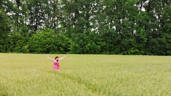 Thumbnail for Beautiful Girl in Red Retro Dress Running in Green Field