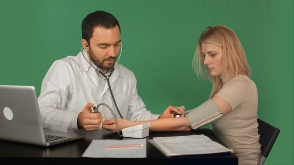 Thumbnail for Doctor and Patient with Blood Pressure Meter in a Hospital on a Green Screen, Chroma Key