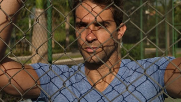 Thumbnail for Guy Leaning Against Fence