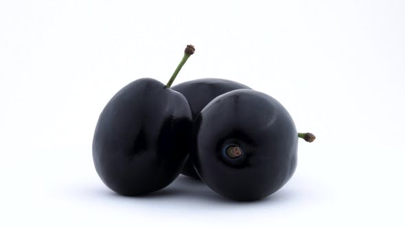 Thumbnail for Three Whole Plum Fruits. Rotated on the Turntable. Isolated on the White Background