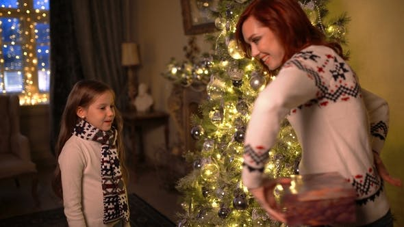 Thumbnail for Mom and Daughter Give Each Other Christmas Presents