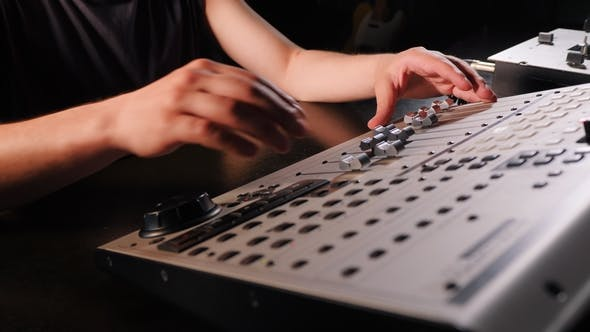 Thumbnail for Unrecognizable Sound Producer or Engineer Rotates Scrolls Wheel on Mixing Console in Professional