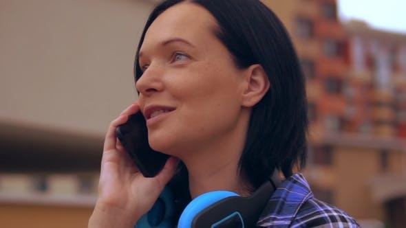 Thumbnail for Tanned Brunette Female Speaking on the Phone