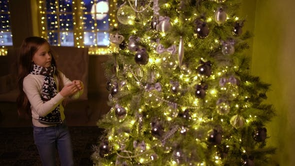 Thumbnail for Little Girl Decorating the Christmas Tree