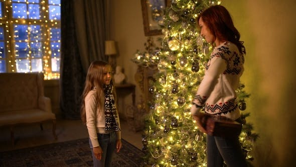 Thumbnail for Happy Mother and Baby with Christmas Gift Near the Christmas Tree at Home