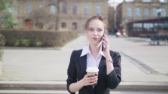 Thumbnail for Businesswoman in City Using Smart Phone with Takeaway Coffee
