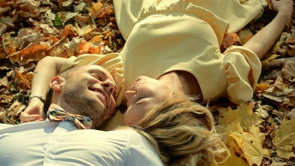 Thumbnail for Smiling Couple Lying in Autumn Park