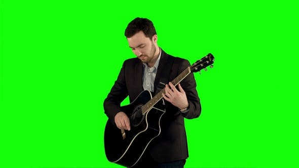 Thumbnail for Young Man Playing Guitar on a Green Screen