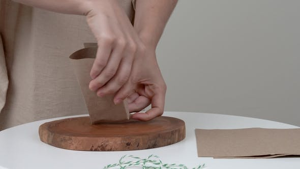 Thumbnail for A  of Woman's Hands Wrapping a Bar of Soap She Is Winding a Rope Around the Parcel and Makes