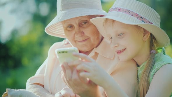 Thumbnail for A Girl Shows Her Grandmother Playing on a Smartphone
