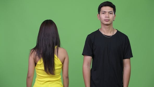 Thumbnail for Young Asian Man with Young Asian Woman Looking at the Back