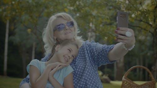 Positive Grandmother Making Selfie with Grandchild