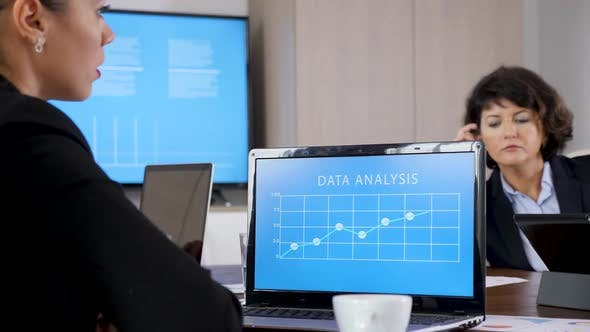 Thumbnail for Laptop with Data Analysis in Front of Business Woman