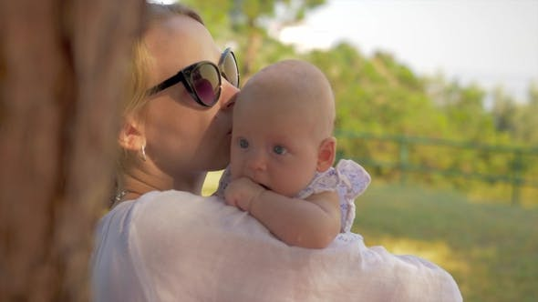 Cover Image for Mother with Baby Spending Summer Day in the Park