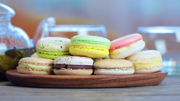 Thumbnail for of Colorful Macaron (Macaroon) on the Table with Hot Tea