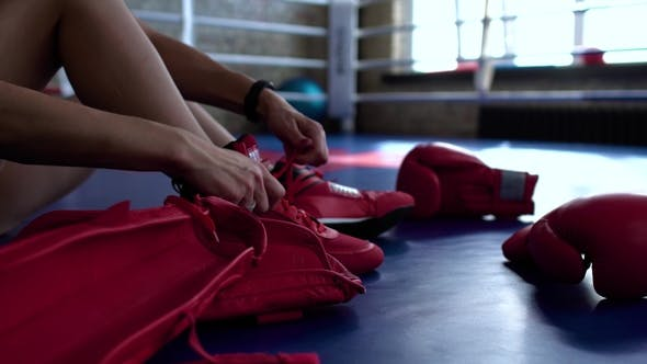 Thumbnail for Sportswoman Tie Shoelaces Before Fighting at Boxing Ring