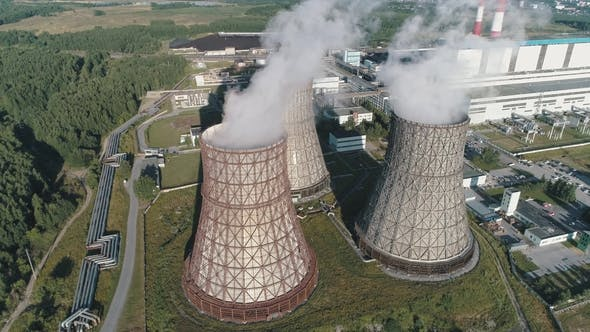 Thumbnail for Aerial View on the Working Power Station Cooling Tower of Nuclear Power Plant. Coal-burning Power