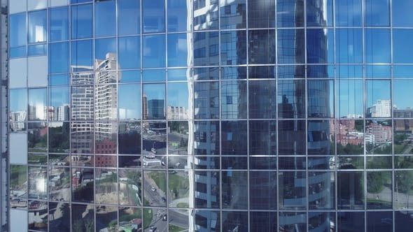 Thumbnail for Reflection in the Windows of a Corporate Building