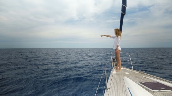 Thumbnail for Young Woman in White on the Bow of Yacht