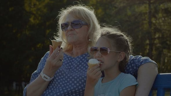 Thumbnail for Kid Eating Eating Icecream with Grandmother Outdoor