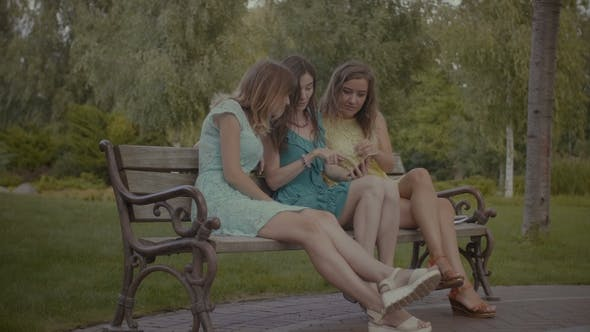 Thumbnail for Excited Girls Watching Media Content on Cellphone