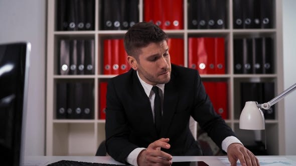 Thumbnail for Young Businessman Having Head Pain During Work in Office