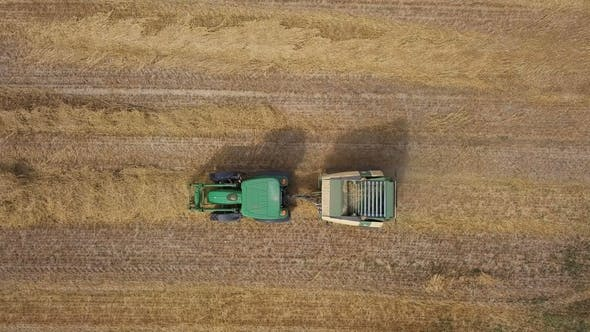 Thumbnail for Aerial of Working Hay Baler Tractor