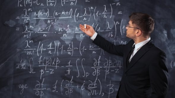 Thumbnail for Young Smart Male Teacher or Student Explaining Decision of Hard Math Equation