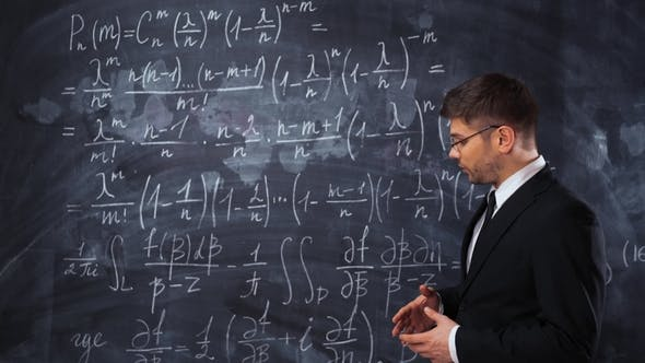 Cover Image for Young Man Teacher or Student Explaining Decision of Hard Mathematic Equation