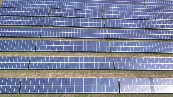 Thumbnail for Aerial View of Solar Panels Farm Solar Cell with Sunlight. Drone Flight Fly Over Solar Panels Field